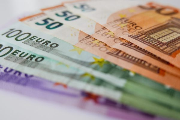 Close-up image of euro bills on white background.